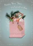 Weihnachtsgrußkarte mit Flitter und Geschenken Stockfotografie