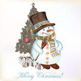 Weihnachtsgrußkarte mit Schneemann und Weihnachtsbaum Stockfotografie