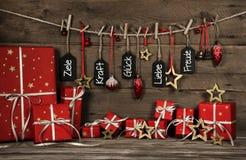 Weihnachtsgrußkarte mit deutschem Text: Ziele, Energie, Glück, lov Stockbilder