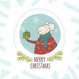 Weihnachtsgrußkarte mit Schafen und Geschenk im Kreis Stockbild