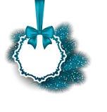 Weihnachtsgutschein mit Band und Tannenzweigen Stockfotos
