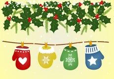 Weihnachtshandschuhe auf den ropechristmas Handschuhen auf der Spitze Stockfoto
