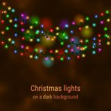 Weihnachtshauslichter auf einem dunklen Hintergrund Lizenzfreie Stockbilder