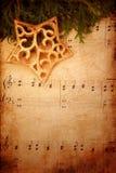 Weihnachtshintergrund mit alter Blattmusik Stockfotografie