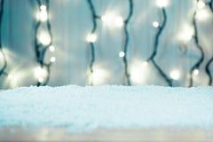 Weihnachtshintergrund mit bokeh einer leuchtenden Girlande Lizenzfreies Stockbild
