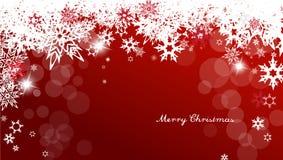Weihnachtshintergrund mit den weißen und roten Schneeflocken Stockbild