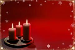 Weihnachtshintergrund mit drei Kerzen Stockbilder