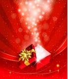 Weihnachtshintergrund mit geöffnetem Geschenkkasten Stockfotografie