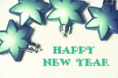 Weihnachtshintergrund mit Glasverzierung in der Sternform mit Text Stockfotos