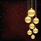 Weihnachtshintergrund mit Goldabendbällen Stockfoto