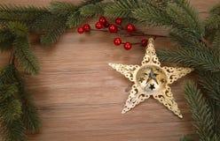 Weihnachtshintergrund mit goldenem Stern Stockfotografie