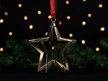 Weihnachtshintergrund mit goldenem Stern Lizenzfreies Stockfoto