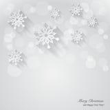Weihnachtshintergrund mit Papierschneeflocken. Lizenzfreie Stockbilder
