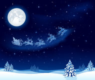 Weihnachtshintergrund mit Santaâs Pferdeschlitten Stockfoto