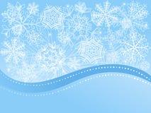 Weihnachtshintergrund mit Schneeflocken. Stockfotos