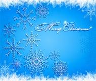 Weihnachtshintergrund mit Schneeflocken Stockbild