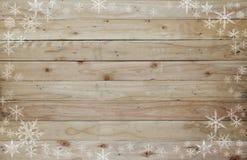 Weihnachtshintergrund mit Schneekristall und hölzernes Lizenzfreie Stockfotografie