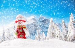 Weihnachtshintergrund mit Schneemann Stockfotografie