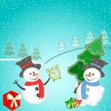 Weihnachtshintergrund mit Schneemann, Baum, Geschenken und Schneeflocken Stockfotografie