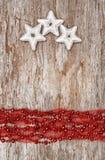Weihnachtshintergrund mit Stern Formen und Chaplet Lizenzfreies Stockbild