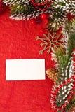 Weihnachtshintergrund mit unbelegter Karte Stockfotos