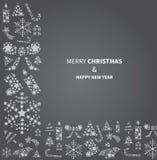 Weihnachtshintergrund mit Weihnachtselementen in der Dunkelheit Stockfoto