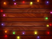 Weihnachtshintergrund - Planked-Holz mit Lichtern Lizenzfreie Stockfotografie