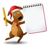 Weihnachtshundeholding-Notizblock Stockfotografie