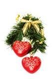 Weihnachtsinnere, die am Tannenzweig hängen Lizenzfreie Stockbilder