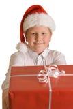 Weihnachtsjunge mit einem Geschenk Lizenzfreie Stockbilder