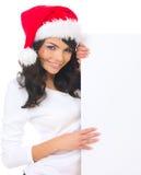 Weihnachtsküken mit Vorstand Stockfoto