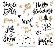 Weihnachtskalligraphiephrasen Hand gezeichnete Auslegungelemente Stockfoto