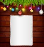 Weihnachtskarte auf hölzernem Hintergrund Stockfoto