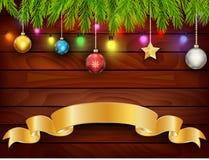 Weihnachtskarte auf hölzernem Hintergrund Lizenzfreies Stockbild