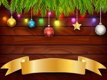 Weihnachtskarte auf hölzernem Hintergrund Lizenzfreie Stockbilder