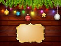 Weihnachtskarte auf hölzernem Hintergrund Stockbilder
