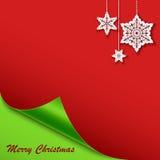 Weihnachtskarte mit der verbogenen Ecke und den Sternen Lizenzfreies Stockfoto