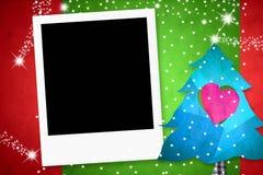 Weihnachtskarte mit einem Fotorahmen Lizenzfreies Stockbild