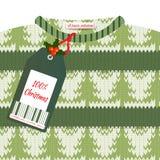 Weihnachtskarte mit einem Grün strickte Strickjacke und Preis Stockfoto