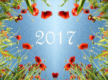 Weihnachtskarte mit einem Herzen von Mohnblumen und Schnee und inscript Stockfotografie