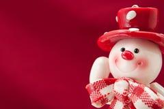 Weihnachtskarte mit einem Schneemann Lizenzfreies Stockbild