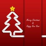 Weihnachtskarte mit gefalteter Papierbaumschablone Stockfotos