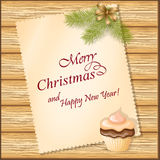 Weihnachtskarte mit kleinem Kuchen Stockfotografie