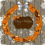 Weihnachtskarte mit Kranz. Lizenzfreie Stockfotografie
