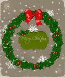Weihnachtskarte mit Kranz. Lizenzfreie Stockfotos