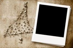 Weihnachtskarte mit leerem Fotorahmen Stockbild