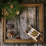 Weihnachtskarte mit Weinleserahmen Stockfotos