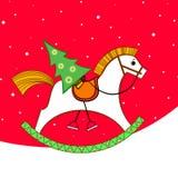 Weihnachtskarte. Schwingpferd Stockbilder