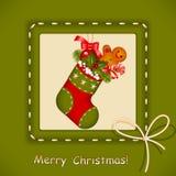 Weihnachtskarte. Strumpf mit roter Kugel Lizenzfreie Stockfotos