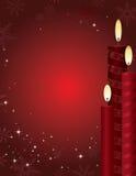 Weihnachtskerze-Hintergrund Stockfotos